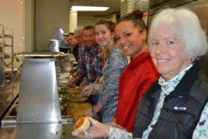 Volunteer serving dinner at the Mission
